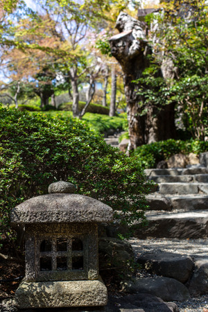 beautiful tradizional japanese garden with pond in the heart of Tokyos sunny weather, april Stock Photo