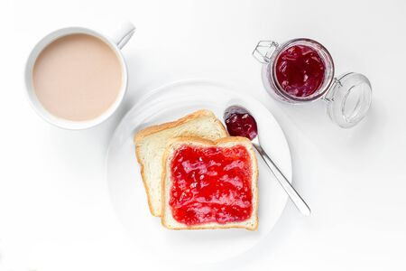 two fresh toast with strawberry jam on the white table, top view, nobody Stock fotó