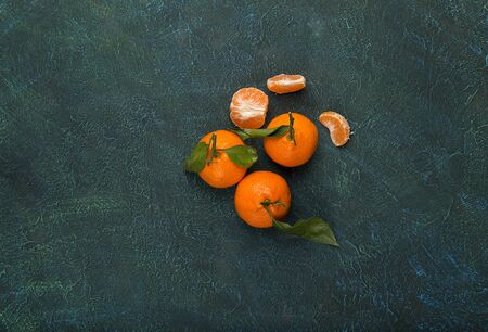 tangerines on a dark green background, free space for your text