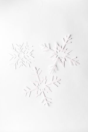 white background with paper snowflakes, top view Stock Photo