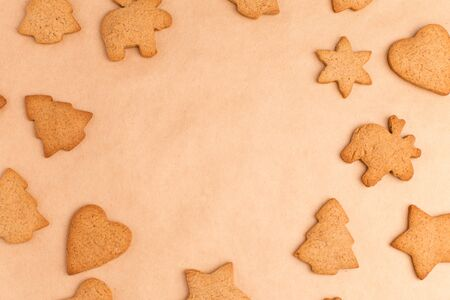 background with ginger different biscuits on craft paper, free space in the center