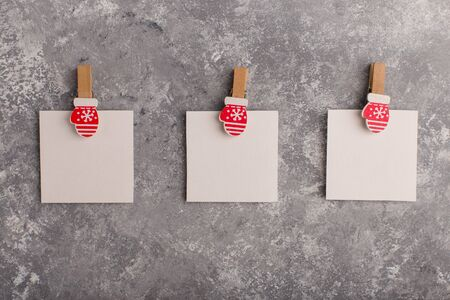 Three christmas card forms on a grey concrete background