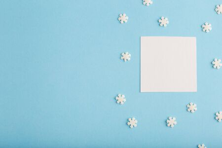 New Years card with snowflakes on a blue background, free space