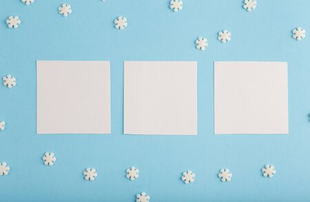 Three New Years card with free space, snowflakes on a blue background