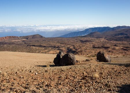 climbing the teide volcano landscape from above, road in clouds