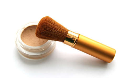 Gold brush for make-up and powder on white background Stock Photo