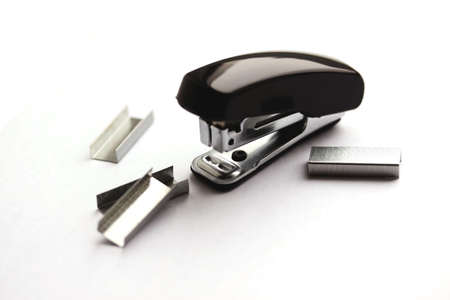 sharpness: Black mini stapler and clips (small depth of sharpness) Stock Photo