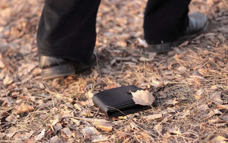 Walking man lost a wallet (outdoors Stock Photo