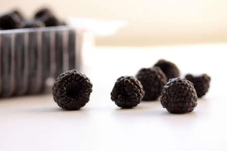 Blackberry on white surface (small DOF)