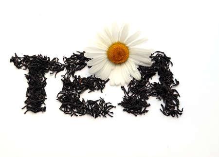 Camomile on tea leaves (word