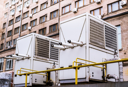 chiller: Air conditioning and water heating chillers for big buildings Stock Photo