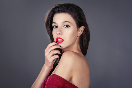 human lips: Portrait of young beautiful brunette woman with bright makeup, red lips