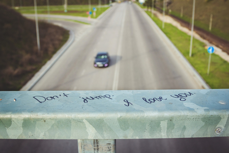 appealing: ZaporizhiaUkraine- April 10, 2016: Message written on a bridge ledge under city road by unknown person, appealing to stop suicide, motivating to live