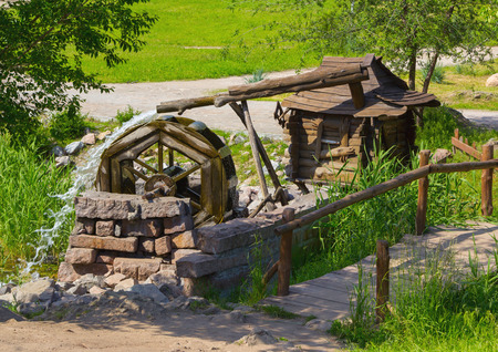 water mill: Old wooden water mill with rotating wheel