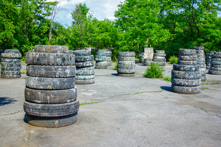 barricades: Abandoned paintball playground with barricades made of old tires with paint marks after fights