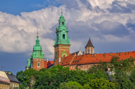 Krakow  Poland - August 14, 2017: view of Wawel Cathedral Towers and museum building over a cloudy dramatic sky on a summer day