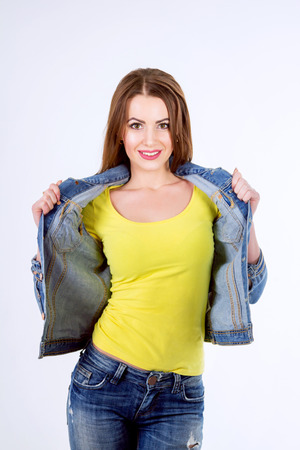 Studio portrait of a beautiful young woman. Casual style.