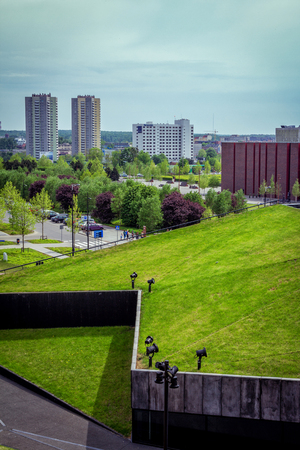 Katowice / Poland- May 2, 2018: spring cityscape with modern buildings, park with colorful trees and green lawns, cars and road Publikacyjne