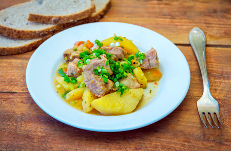 Served lunch or dinner with stewed potato with meat and cut onion. Stock fotó