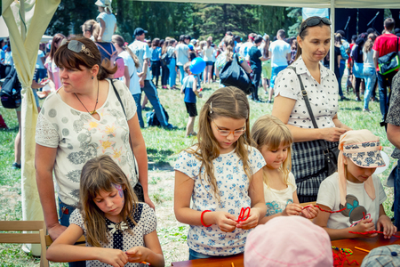 Zaporozhia / Ukraine- June 2, 2018: An outdoor couple, a small couple of girls, an artwork, a girlfriend and a girlfriend. children activity and entertainment.