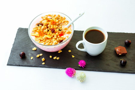 Berry yoghurt with granola in cup Served breakfast.