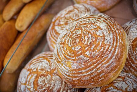 Freshly baked homemade bread with golden crispy crust. Food background. Banque d'images - 132098700