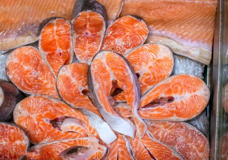 Raw fresh salmon slices. Red fish steak and fillet at the market. Healthy food.