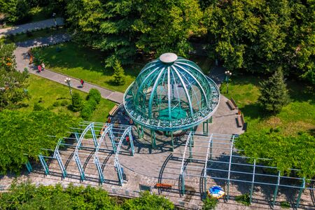 Borjomi/Georgia – July 17, 2019: Top view of famous Georgian mineral water – Borjomi – hot source under blue pavilion in a park.  Famous resort in a mountain village. Editorial