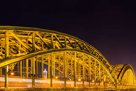 of irradiated: Hohenzollern Bridge at night in Cologne