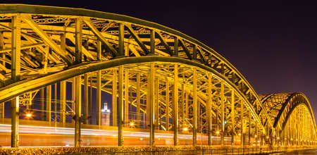 Hohenzollern Bridge at night in Cologne