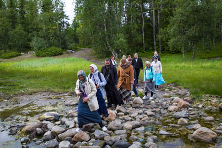 Solovki, Russia - June 26, 2016: The pilgrimage in the forest on Solovetsky island