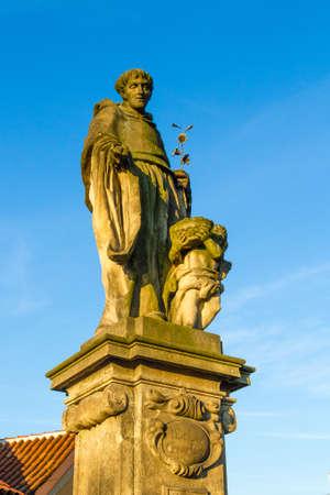 Religious statue at Charles Bridge Prague. Czech Republic. Standard-Bild