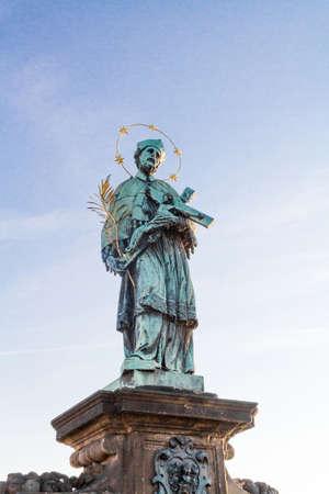 Statue of St. John Nepomuk on Charles Bridge in Prague.