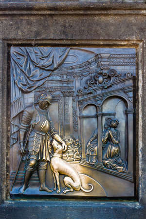 An old relief below the statue of St. John of Nepomuk on Charles Bridge in Prague, Czech Republic. Standard-Bild