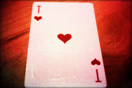 amusment: playing card ace  hearts  one isolated on red