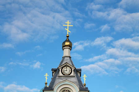 crucifixes: roof with golden dome and shine crucifixes on Orthodox church sink  in blue sky