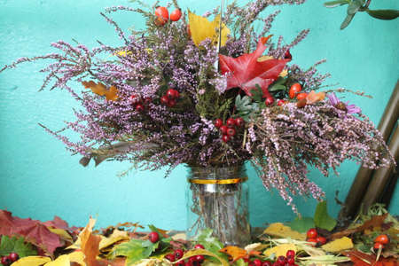 pompous: pompous autumn bouquet from bloom bright violet heather decorated with red ripe berries of dog-rose and hawthorn, leaves of maple and oak