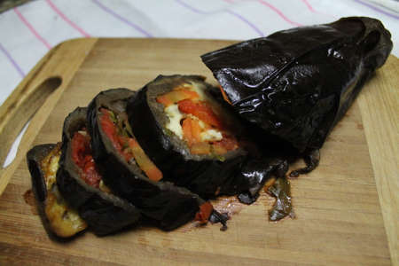 pulp eggplant baked with fresh vegetables inside