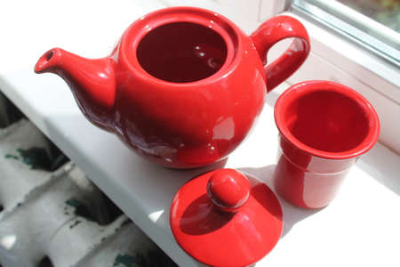 claen: red clay teapot with top and sieve prepare for green tea every time Stock Photo