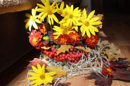 bright bouquet of autumn gift, yellow flowers, red rawberries, leaves, oak nice decoration and for mood