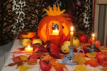 cinderella pumpkin: prepare celebration Halloween holiday ginger pumpkin in shape of cinderella carriage, apples, candles, leaves
