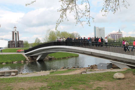 view on chapel and bridge across the river Svisloch on island of tears memorial of warriors of war, Minsk, May, 2015, Belarus