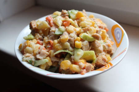appetizing vegetarian salad from young corn under sauce