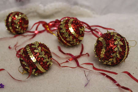 red shine balls with ribbons decoration for holiday