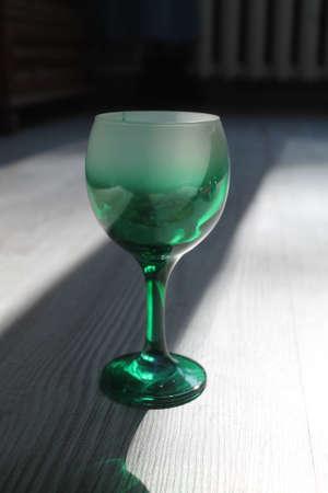 green wineglass in light 写真素材