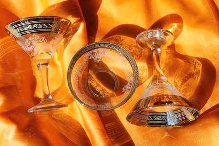 crystal wineglass on golden silk