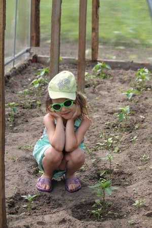 little girl help in gardening Stock fotó