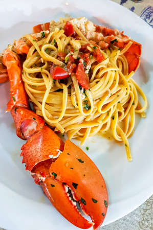 Italian seafood pasta - Spaghetti with big lobster. Close up. Calabrian restaurant
