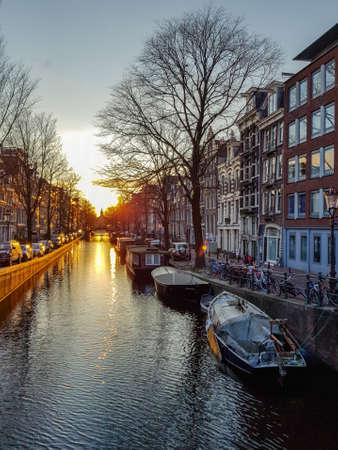 Winter sunset on the Amsterdam canal with reflection Imagens