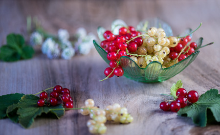In the green bowl a portion of summer berries